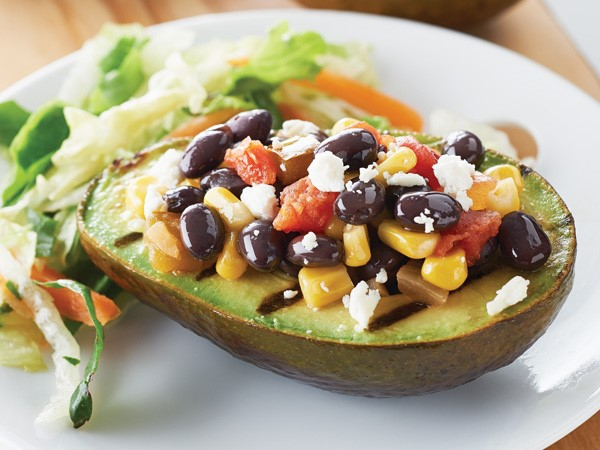 Avocados stuffed with cheese, beans, and corn