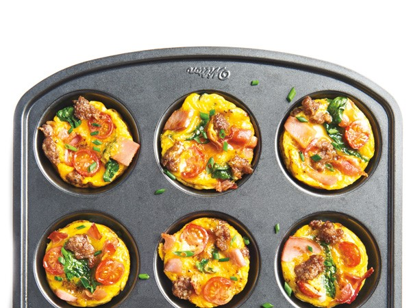 Muffin pan filled with breakfast egg cups