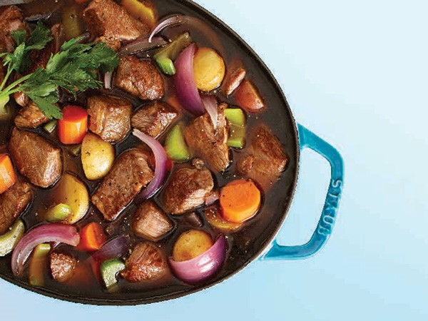 Beef and vegetable soup in a Dutch oven