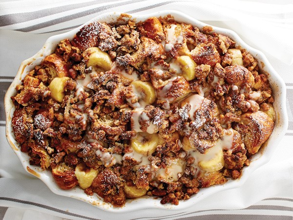 White casserole dish filled with banana streusel croissant bread pudding