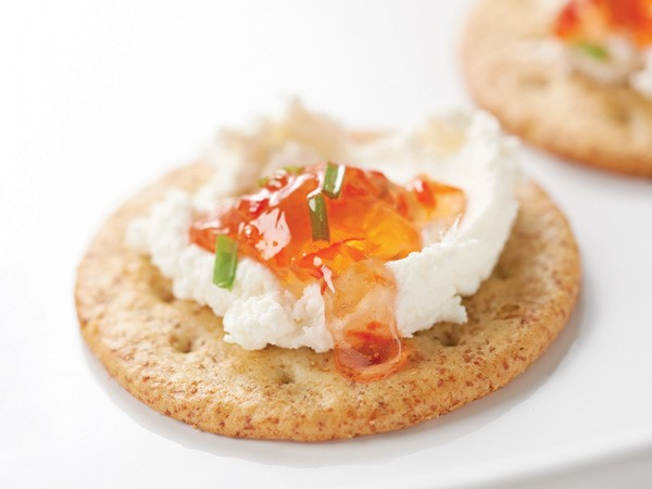 Red pepper jelly and cheese on a cracker