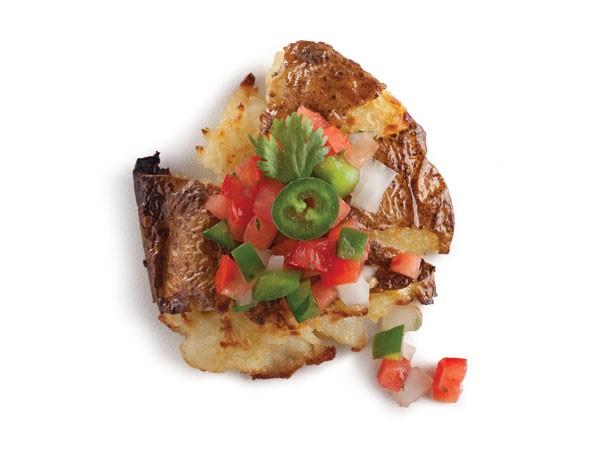 Smashed potatoes topped with pico de gallo