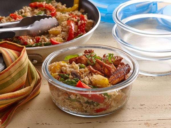 Stir fried cauliflower rice with Asian vegetables and sriracha marinated pork