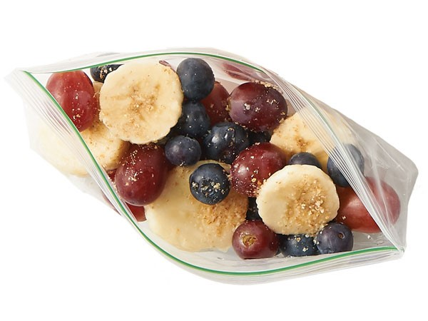 Grapes, blueberries and sliced bananas in a plastic baggie