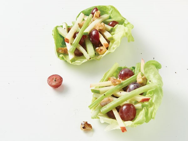 Two lettuce wraps filled with chicken waldorf