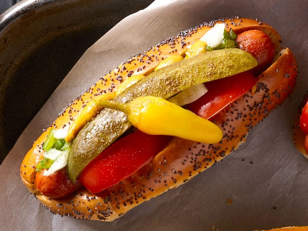 Classic Chicago hot dog topped with sweet pickle relish, onion, tomato, dill pickle, red peppers and mustard