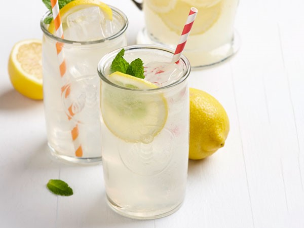 Lemonade in glassed garnished with mint, lemon slices, and fresh mint