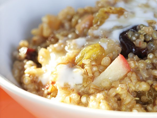 Quinoa oatmeal topped with fresh and dried fruit