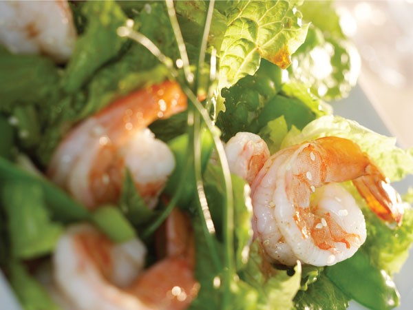 Greens topped with shrimp and sesame-soy vinaigrette