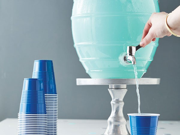 Blue punch poured from a large dispenser