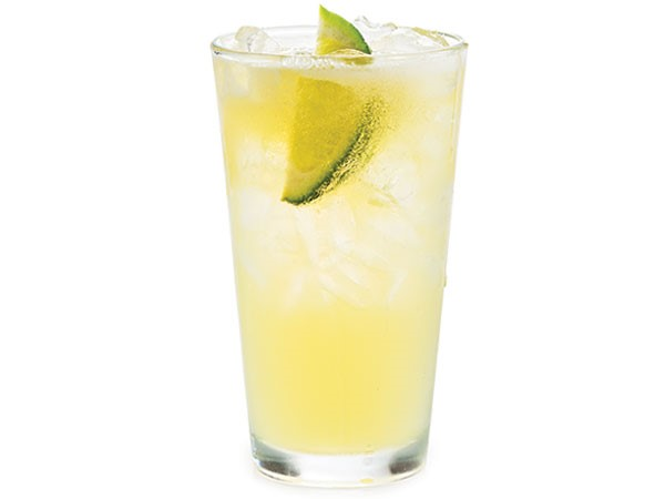 Carona beerrita in glass filled with ice and garnished with lime wedge