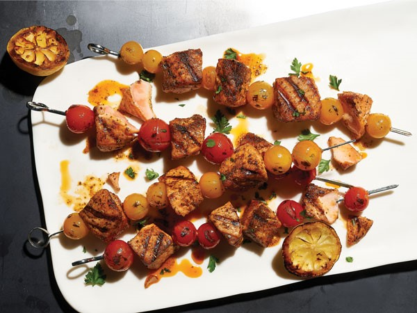 Grilled salmon kabobs with tomatoes on skewers