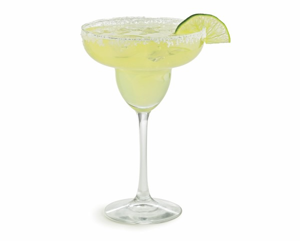 Salt-rimmed margarita glass filled with authentic margarita with a lime wedge