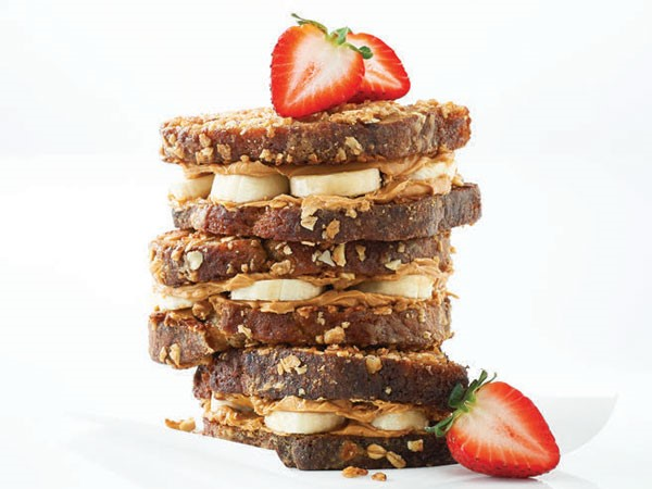 Stack of banana bread french toast layered with peanut butter and banana slices