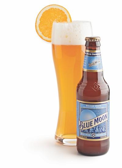 Blue moon beer bottle with beer in hefeweizen glass and orange slice on rim