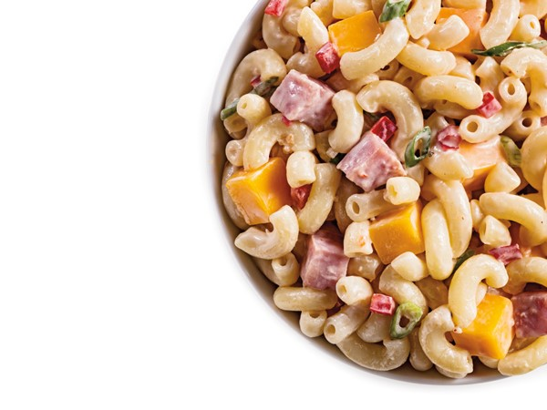 Diced ham and cheese pasta salad in white bowl