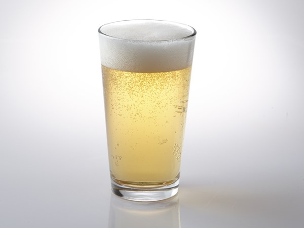 American lager in glass with foam