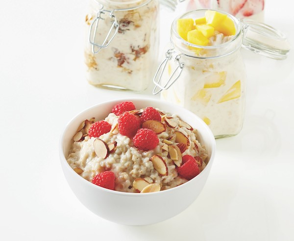 overnight oatmeal in a bowl with jars in background