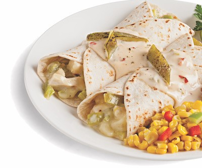 Two enchiladas filled with chicken and hatch chiles served with a side of corn on a white plate
