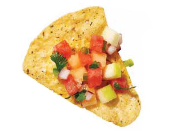 Tortilla chip topped with apple melon salsa