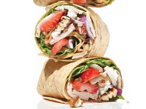 Three strawberry arugula salad wraps stacked on each other