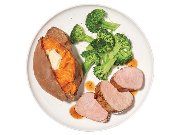 Plate of sliced pork tenderloin with sweet potato and broccoli