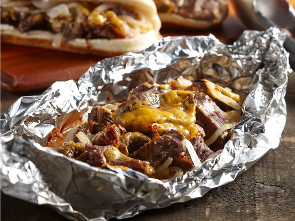 Aluminuim foil filled with beef sirloin, onions and melted cheddar cheese