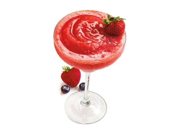 Strawberry daiquiri garnished with strawberries and blueberries