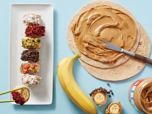 Banana sushi rolls topped with crushed cereal, coconut or nuts