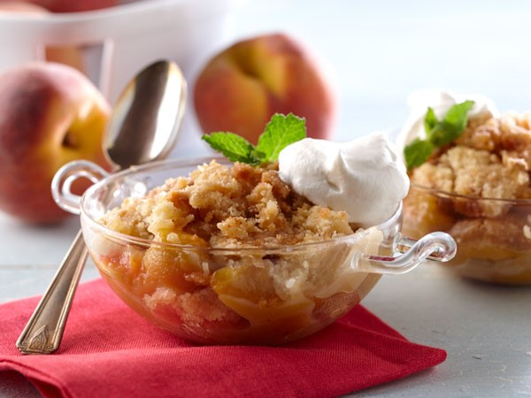 Bowl of Peach Crumble, Topped with Whiskey Whipped Cream