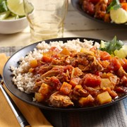 Plate of chicken vindaloo served with a side of rice