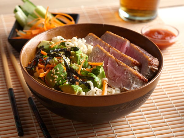 Bowl of tuna, avocado, ramen noodles and shredded vegetables