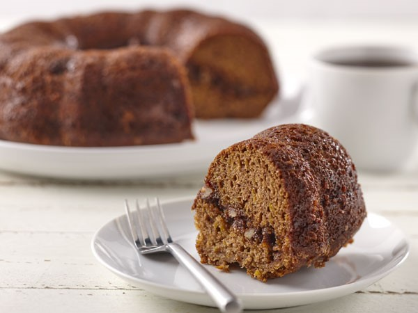 Slice of butternut squash coffee cake on a plate with a fork