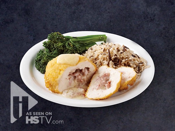 Stuffed Chicken breasts on a plate with steamed broccoli and rice