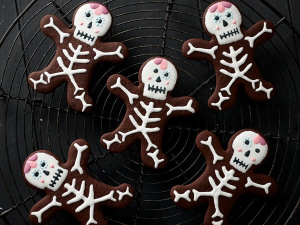 Chocolate skeleton cookies on wire rack