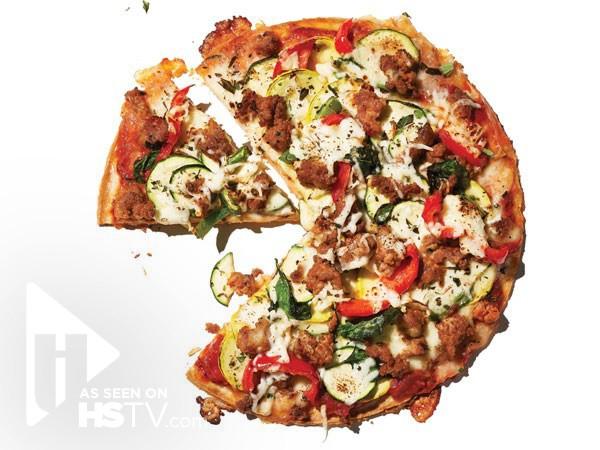Cauliflower crust pizza with sausage and veggies