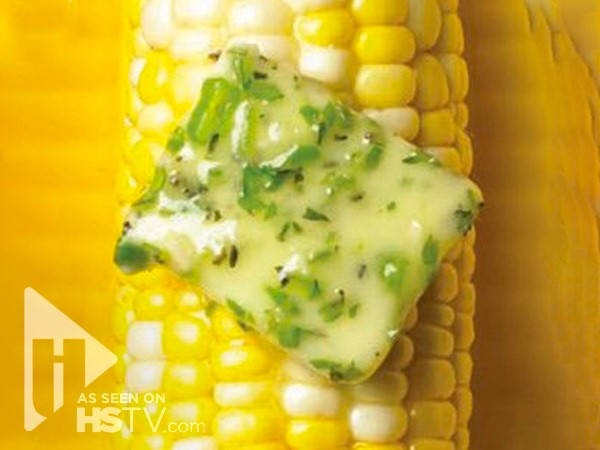Herb butter on an ear of corn