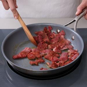 Saute steak in skillet
