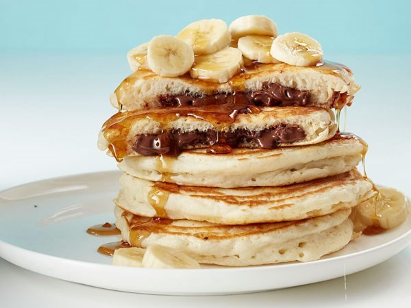 stack of nutella stuffed pancakes on a plate