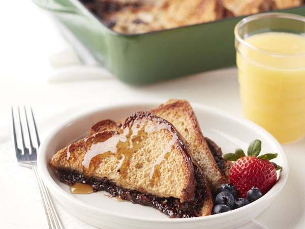 French toast stuffed with chocolate hazelnut spread on a plate with berries