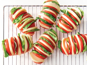 Hasselback tomatoes stuffed with fresh basil and fresh slices of mozzarella