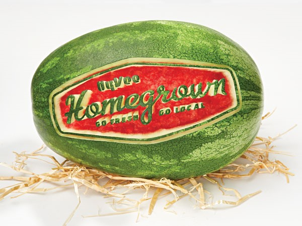 Whole watermelon with Homegrown logo carved into it.