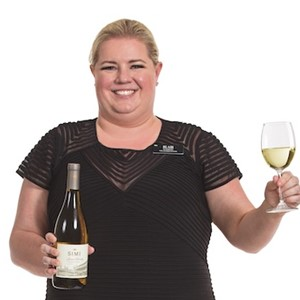 Hy-Vee Sommelier Blair Zachariasen holding a glass of white wine