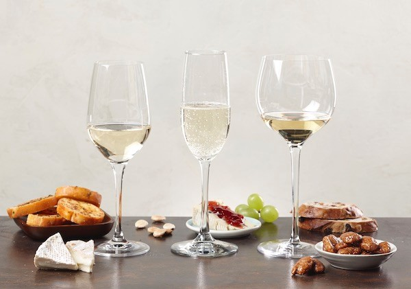 Three glasses with white wines and appetizers
