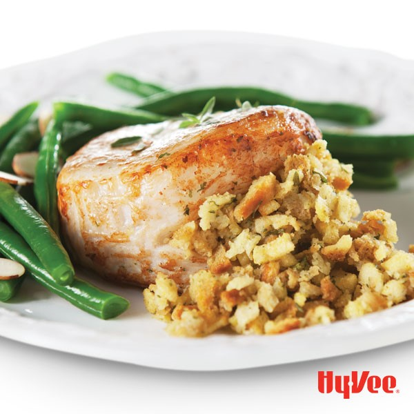 Plate of pork chops served with stuffing and green beans