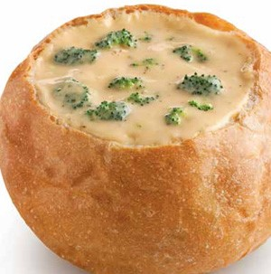 Bread bowl filled with broccoli cheese soup