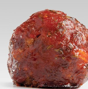 Single meatball topped with sauce