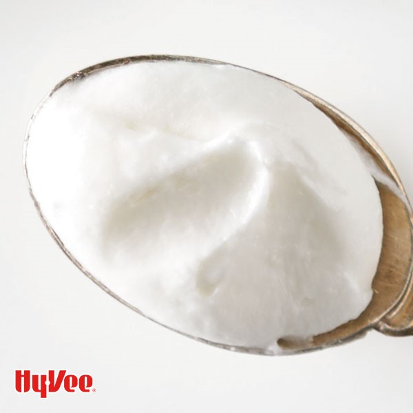White frosting in a metal spoon