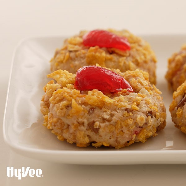 Plate of Cornflake cookies topped with Maraschino Cherry