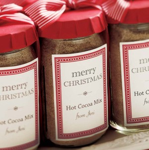 Glass jars filled with hot cocoa mix with label on front of jars